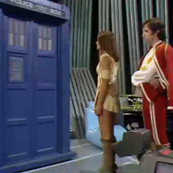 Leela, Andred, and K9 stand next to the TARDIS as it dematerializes